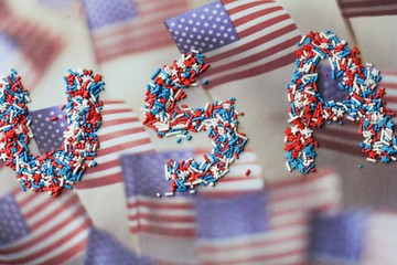 4th of July background / USA word written with sprinkles, selective focus