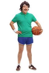 Retro young man holding a basketball