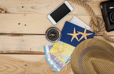 Accessories for travel. Passport, photo camera and travel map. Top view. Holidays and tourism concept