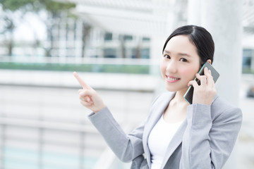 business woman speak smart phone