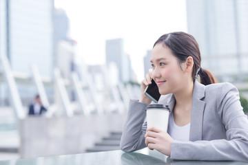 business woman speak smart phone