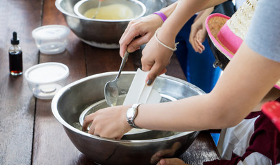 Children hand making home made ice cream cooking class. Spinning steel bowl for making Vanilla Ice Cream. stirring Hand made ice cream in steel bowl. Children learning cooking in bakery class.