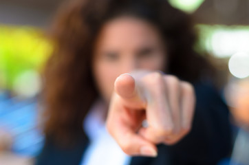 Woman pointing an accusatory finger at the camera