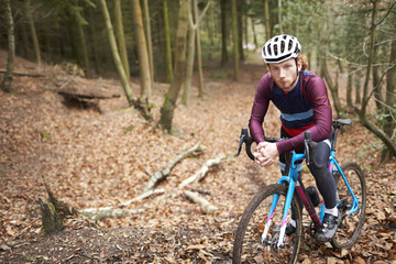 Portrait of man cross-country cycling in a forest, close up