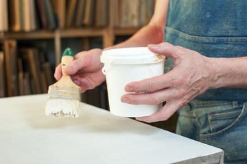An artist priming canvas Selective focus