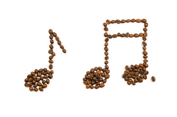 Music notes made of roasted coffee beans on a white background