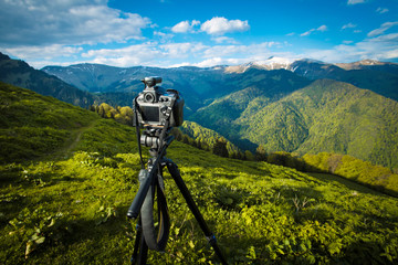 Camera on tripod in the mountains