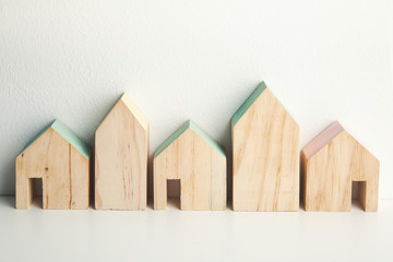 Wooden houses on the wall background