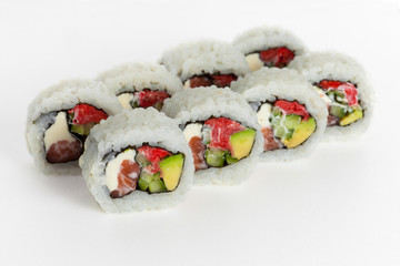 Sushi rolls with fish, cheese and avocado on a white background