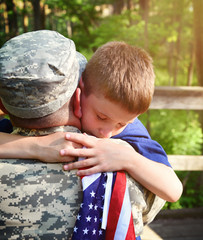 Soldier Father and Son Hugging with American Flag