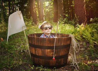 Fishing Boy Relaxing in Wooden Boat in Forest