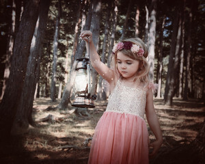 Child Fairy Holding Lantern Light in Woods