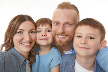 Happy family taking selfie isolated on white