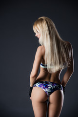Sexy woman's sport buttocks in violet lingerie. Beautiful female body part. Sexy female buttocks. Beautiful female slim body.