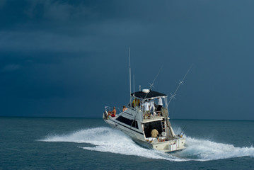 Sport Fishing Boat heading out as a storm approaches.