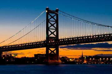 A Sunset View of  The Benjamin Franklin Bridge, Philadelphia, Pennsylvania from the Delaware River.