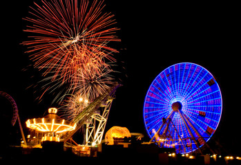 Fireworks explosions in the night sky above the amusemant pier in Wildwood, New Jersey