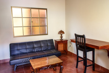 small office with table, chair and sofa