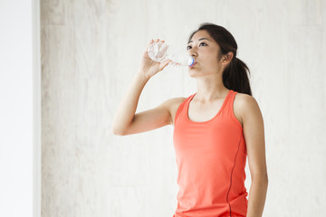 Young women are drinking water in between training