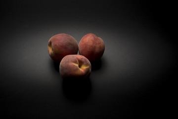 peaches on dark background