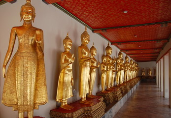 Buddhas at Wat Pho long galery. The temple was built in XII century in Bangkok, Thailand