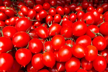 Top view of many cherry tomatoes at the market