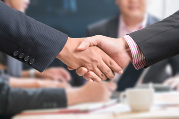 Welcome on board! Close-up of two businessmen shaking hands and