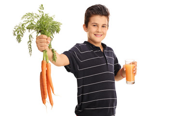 Kid holding carrots and a glass of juice