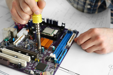 Man hands repair computer parts
