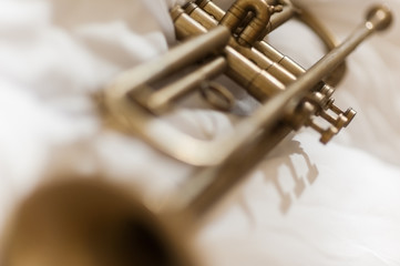An artistic close up of a trumpet