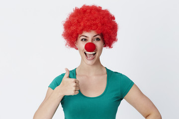 Thumbs up clown in red wig, studio