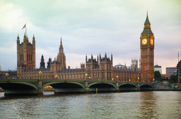 Poster Londen LONDON, UK - JULY 21, 2014: Big Ben and Houses of Parliament at sunset and first night lights