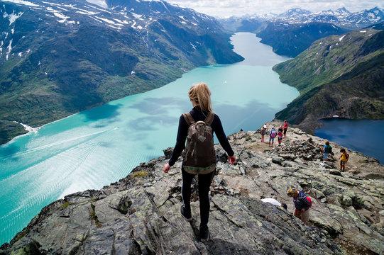Blond, young woman hiking  Besseggen, Jotunheimen,