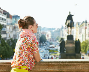 Woman looking into the distance at Wenceslas Square in Prague