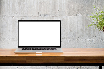 laptop on wooden desk with concrete wall background Wall mural