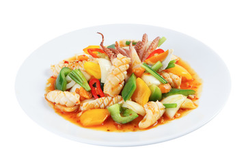 Stir-fried squid with salted egg yolk isolated on white