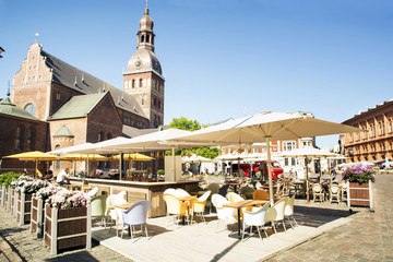 Evangelic -Lutheran cathedral in Riga. Cafe on the square in front of it. Europe. Riga
