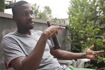Young man enjoying a beer