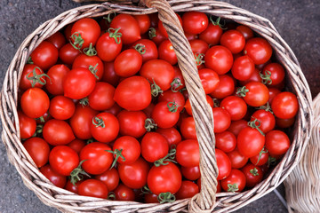 Red tomatoes in basket. Top view, High resolution product.