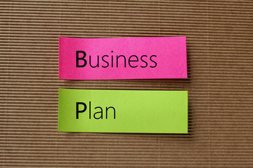 Business Plan text on colorful sticky notes