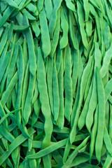 Heap green beans on the market