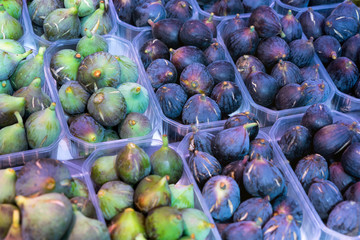 Fresh fruit of green and purple figs in basket