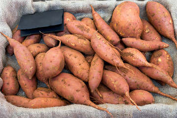 Batata. Raw sweet potatoes in a box.