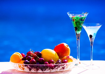 Drink. Margarita and absinthe, fruits and berries, blue backgrou
