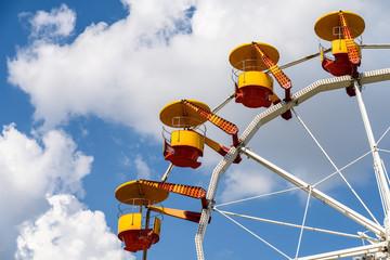 Giant Ferris Wheel In Fun Park On Blue Sky