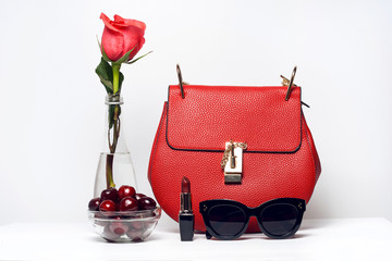 Fashion woman accessories. Handbag and sunglasses