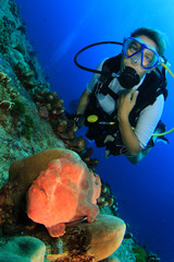 Young woman scuba diver and Giant Frogfish (Anglerfish)