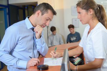 Receptionist explaining to client