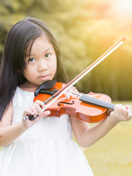 cute asian girl play violin