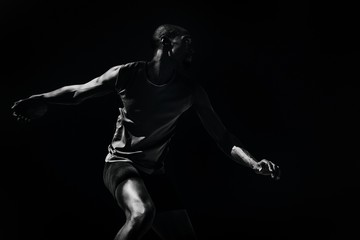 Composite image of athlete man throwing a discus Wall mural